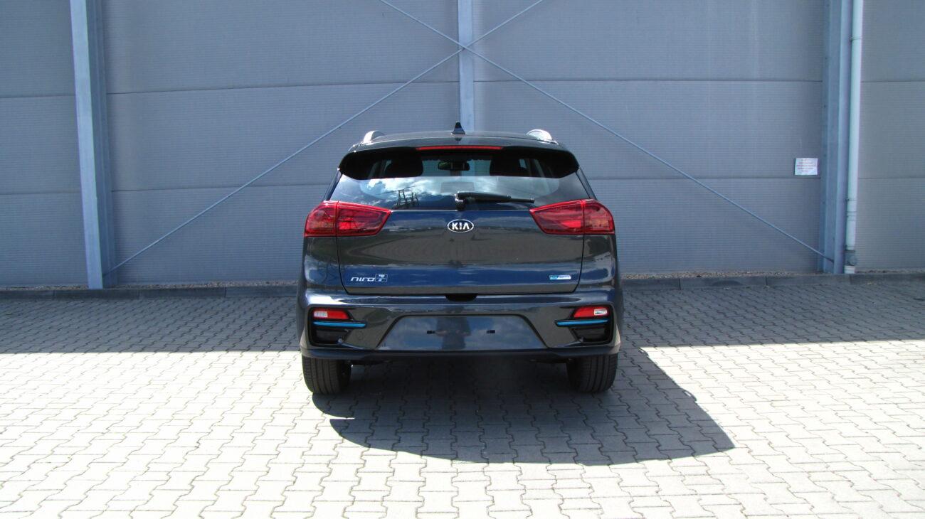 Kia E-Niro - AGT (InterstellarGray) -  Nissan Odyssey